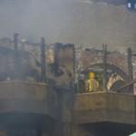 Firefighters near roof